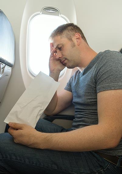 Zvracení v letadle při cestě do USA